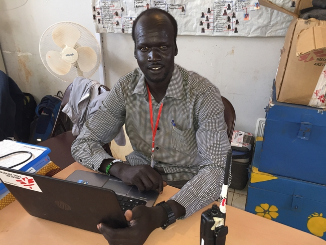 Peter at his desk. Dan Acheson - South Sudan