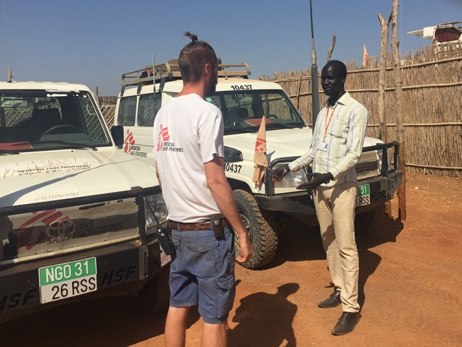 Peter with vehicles - Dan Acheson South Sudan