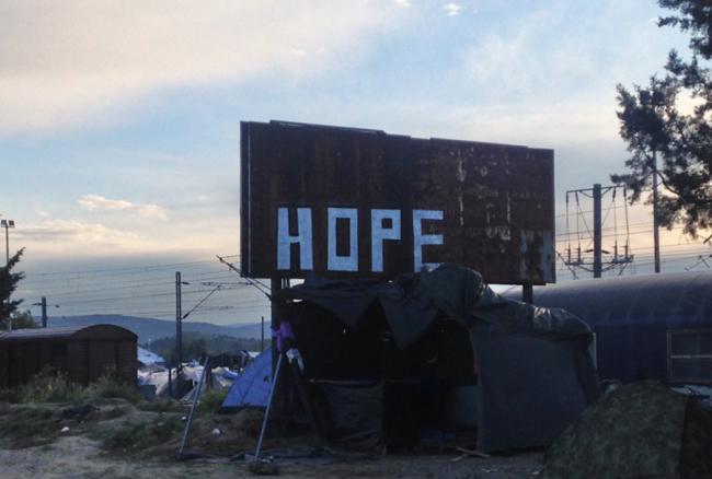 Handmade sign reads 'HOPE';.