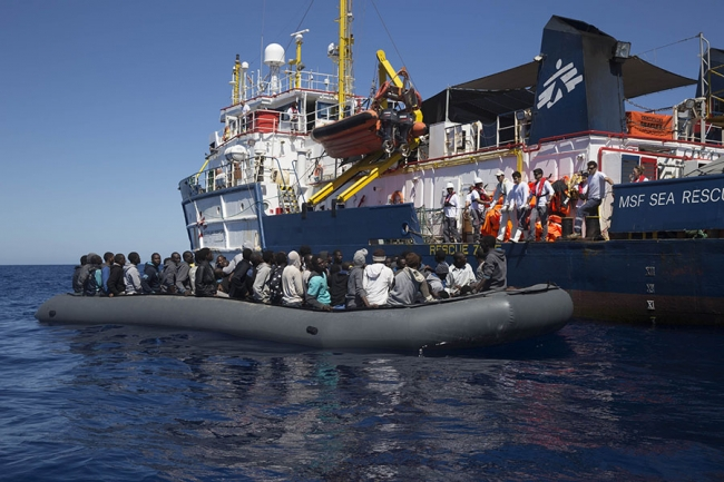 A rescue taking place - the rubber boat draws alongside the ship
