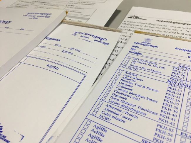 Theresa's paperwork in Khmer and French