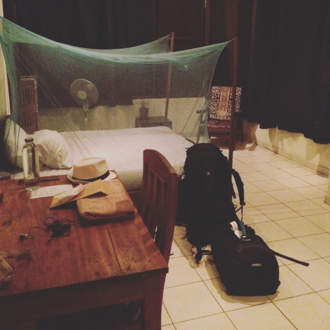 MSF doctor Ludvig's bedroom in Kinshasa is dominated by the large mosquito net over his bed.