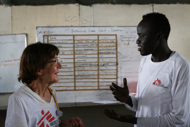Image shows Ros in discussion with a (much taller) South Sudanese colleague