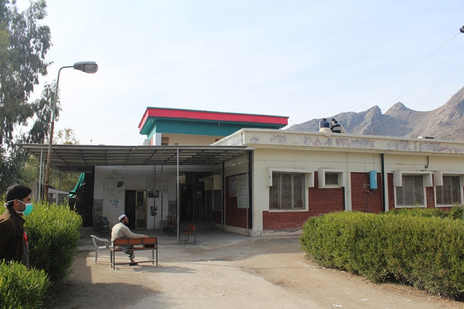 The hospital with the mountains in the background