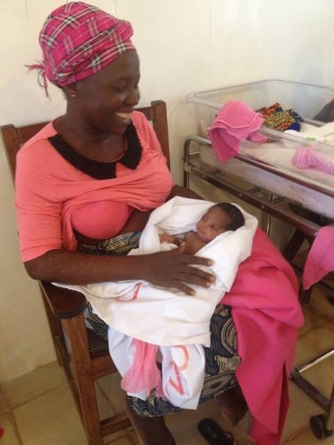 "This is the lady from ""United We Stand"". Baby is 3 weeks and 5 days in the picture and doing well!"