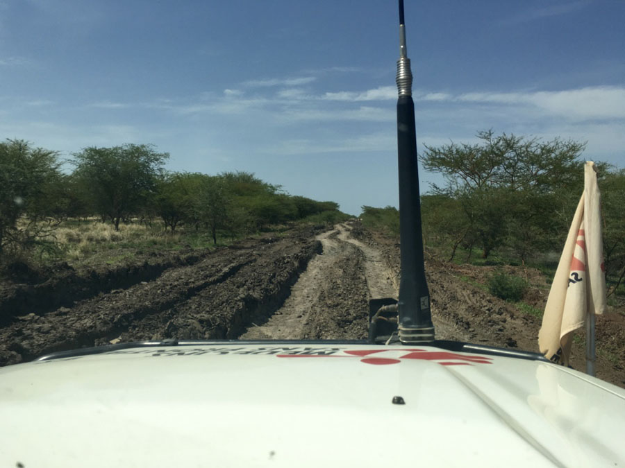 The view from the land cruiser, of the muddy road ahead