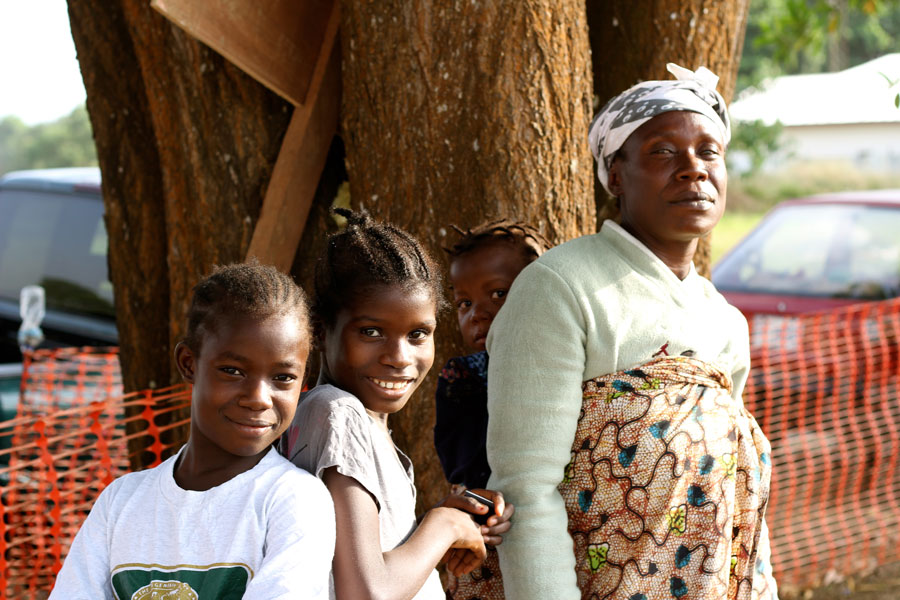 Mother with three of her children who have survived Ebola © CaitlinRyan/MSF
