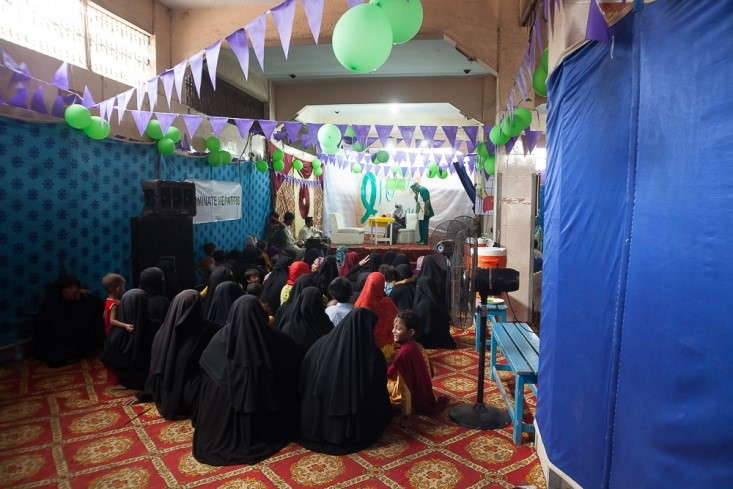 The team put on a health promotion play to a crowd of women and children