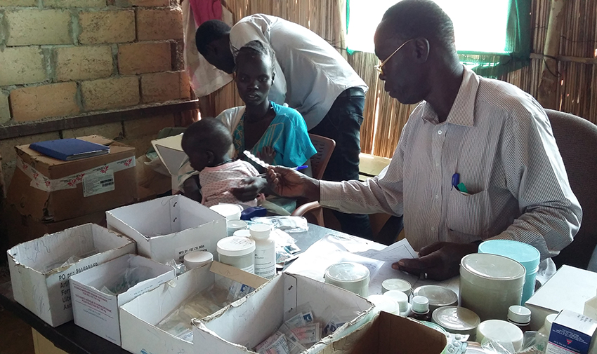 A pharmacy assistant at work in the Khor Wharal Hospital, White Nile State, South Sudan