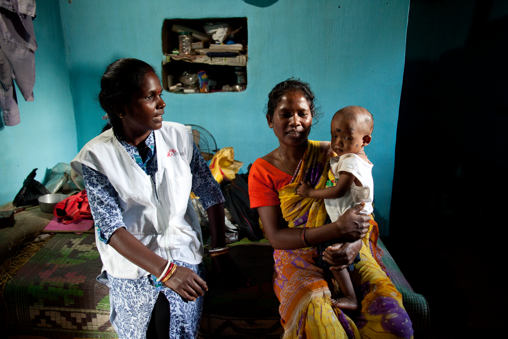 Subashini speaks to Jhinki, the mother of 14 month old Murli who has been successfully treated for severe malnourishment. Photo: Nikhil Roshan
