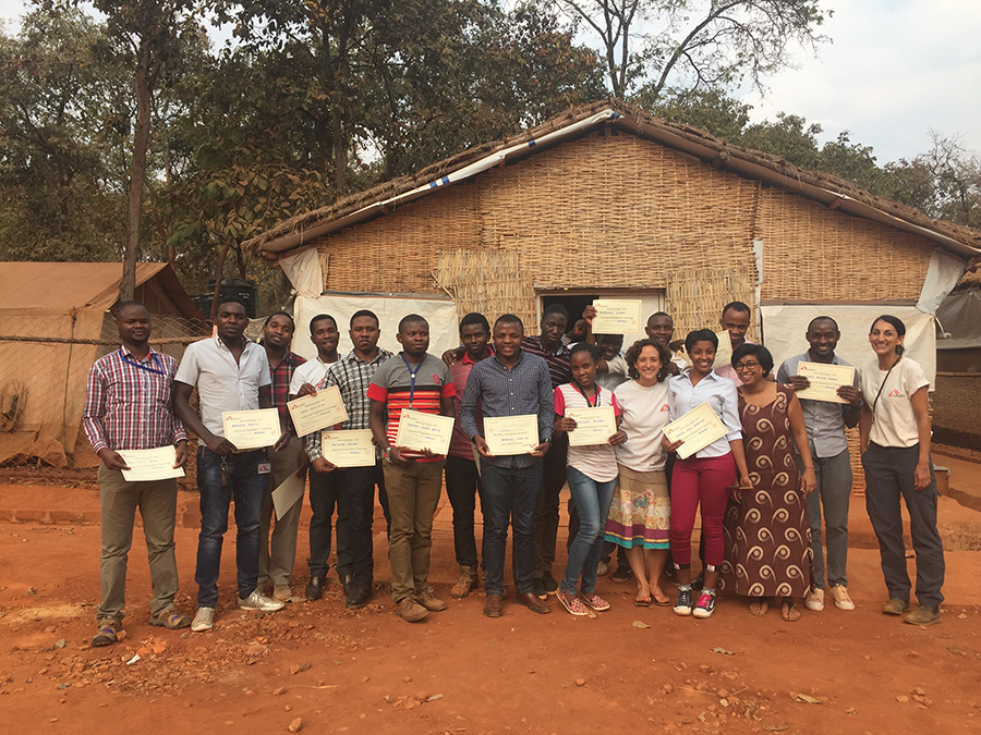 Saschveen stands wih the 16-strong MSF clinical team, all holding their certificates from a paediatric training