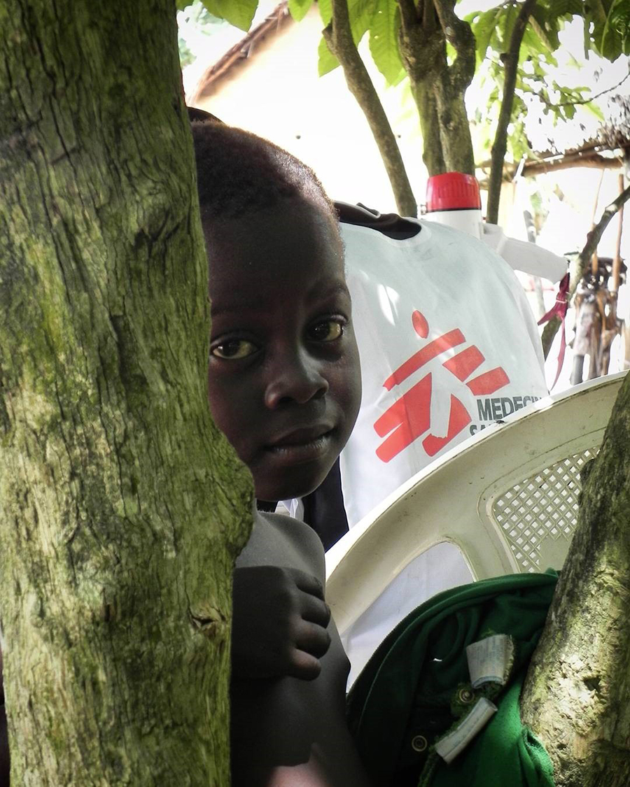 A young boy at an MSF screening camp for HAT and malaria in DRC