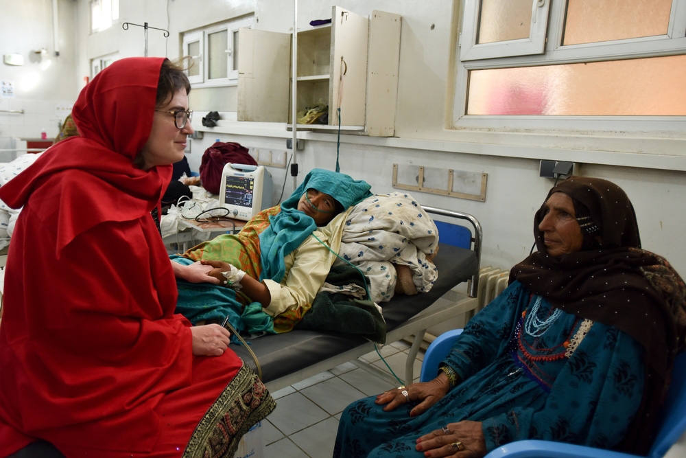 Image shows Severine Caluwaerts, MSF obstetrician, consulting with a patient's family