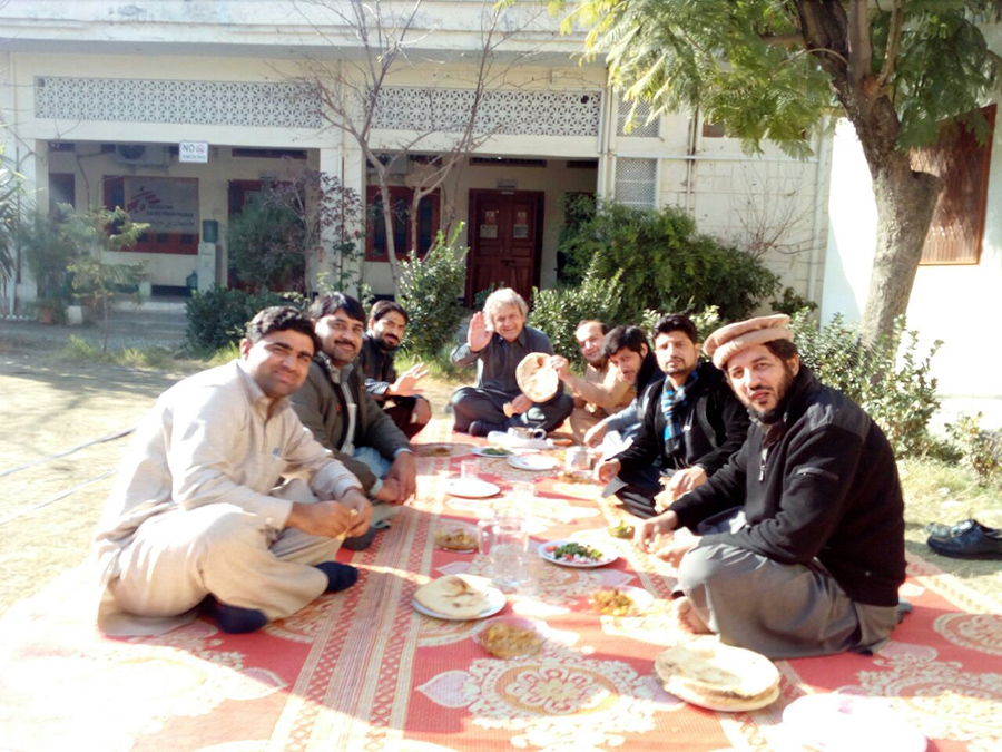 Eben and others from the MSF Pakistan team sharing an outdoor meal