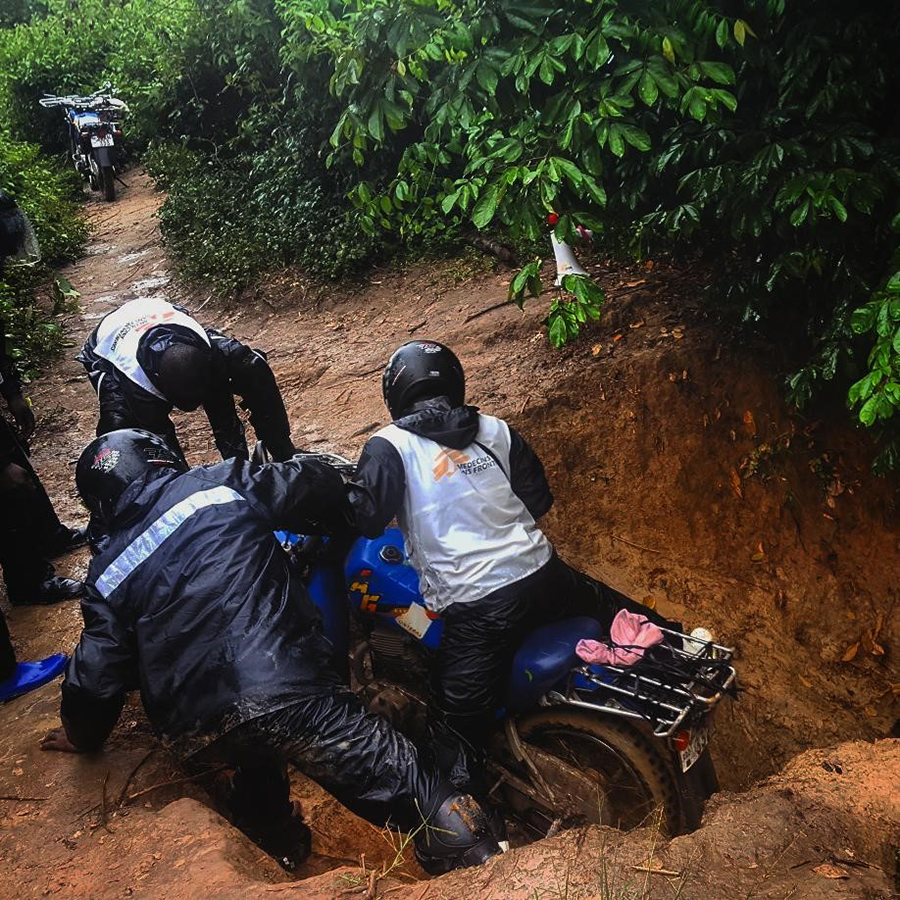 MSF motorcycles battle up a muddy trail in DRC