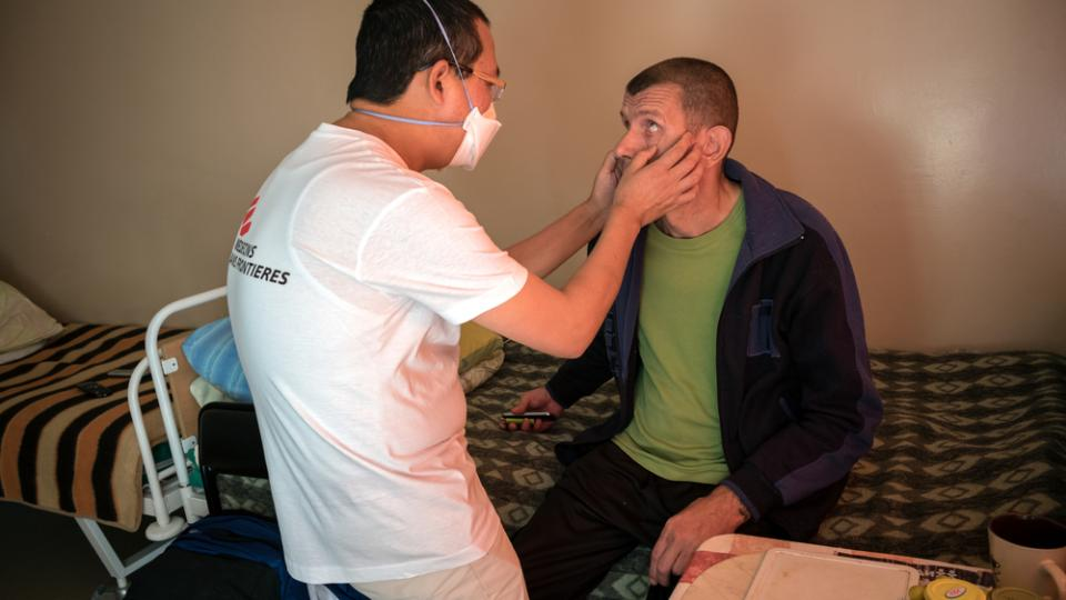 An MSF team member examines a patient with multidrug-resistant TB in Minsk