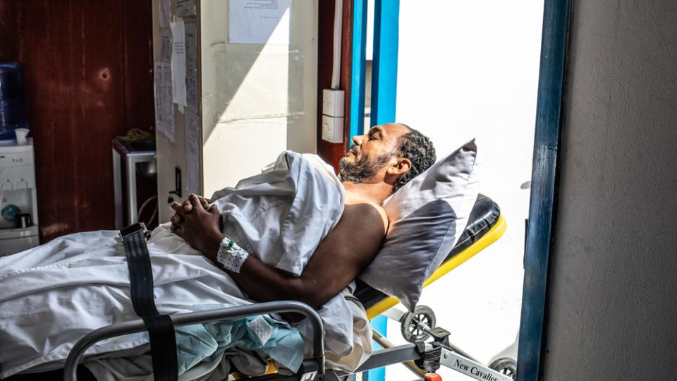 A patient lies on a stretcher in MSF's project in Mocha, Yemen