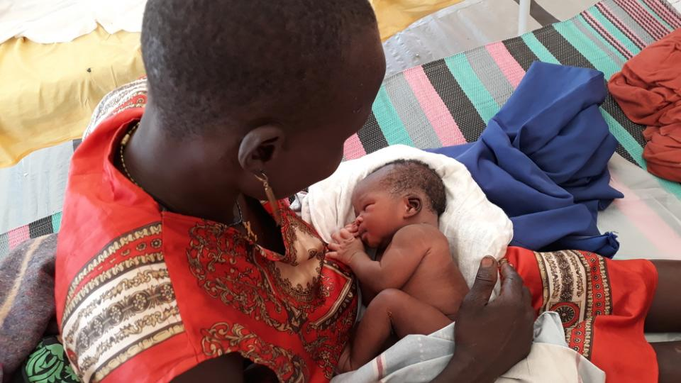 A mother with her newborn baby in the maternity ward in Leer, South Sudan