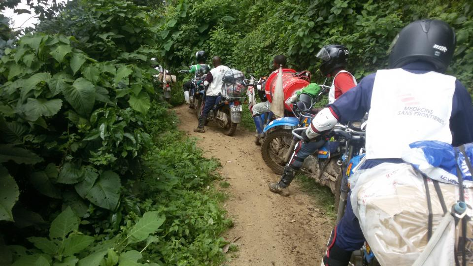 MSF vehicles travelling through the mud in DRC