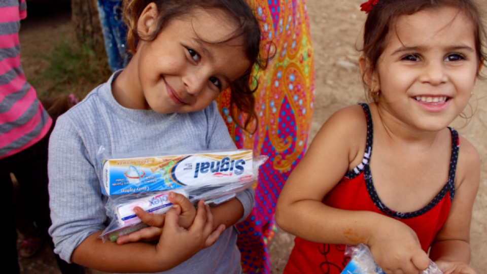 Two girls with hygiene kits