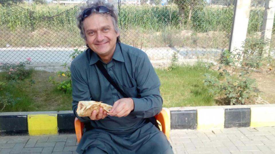 Eben van Tonder eating lunch in Pakistan