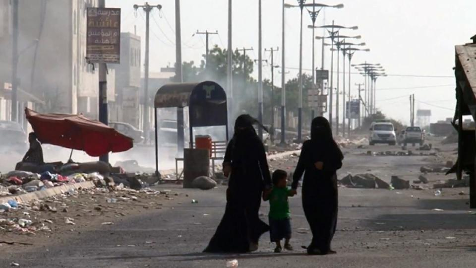 women and children walk through the streets of Taiz