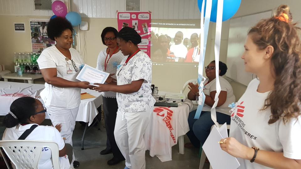 The team receive certificates on international nurses' day.
