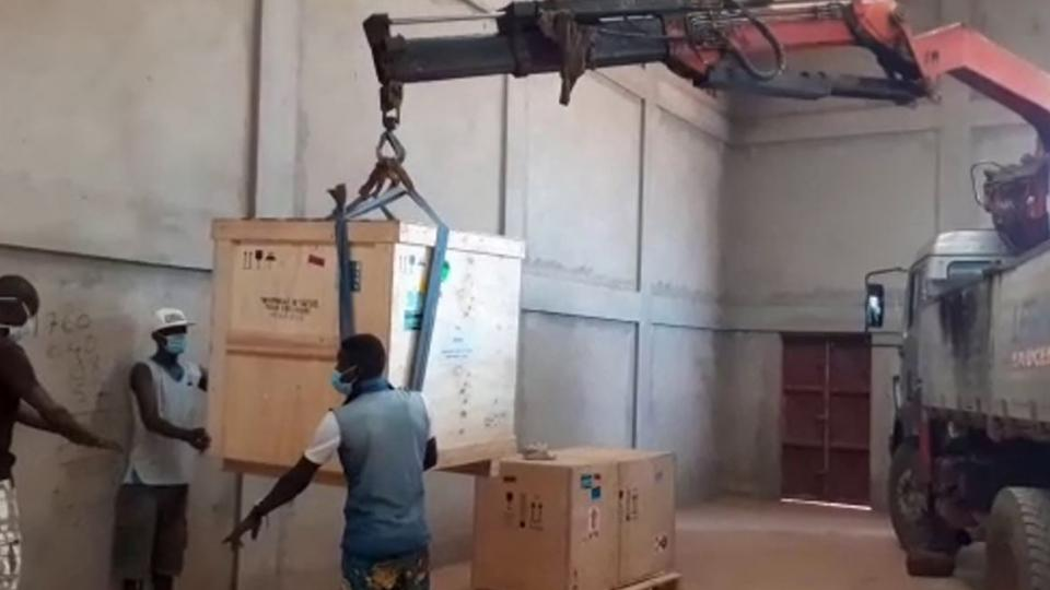 Parts of the oxygen plant being loaded onto a truck in Burkina Faso
