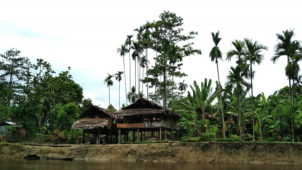 A traditional wooden house on stilts