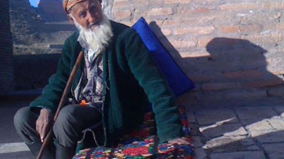 A Tajik elder sitting on a mat