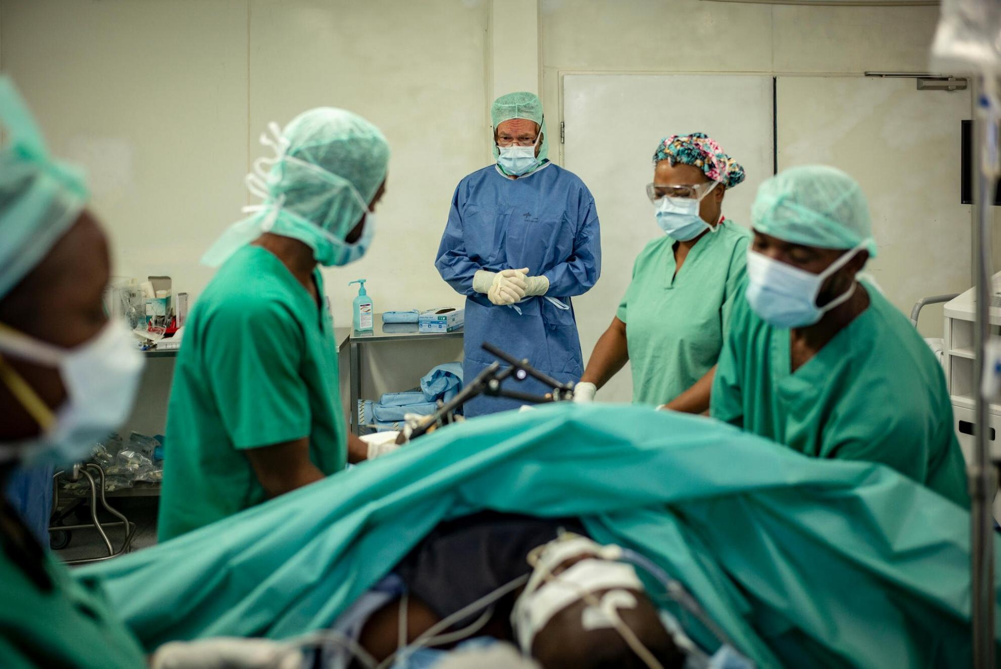 An MSF surgical team at Tabarre trauma hospital in Haiti prepare to treat a patient