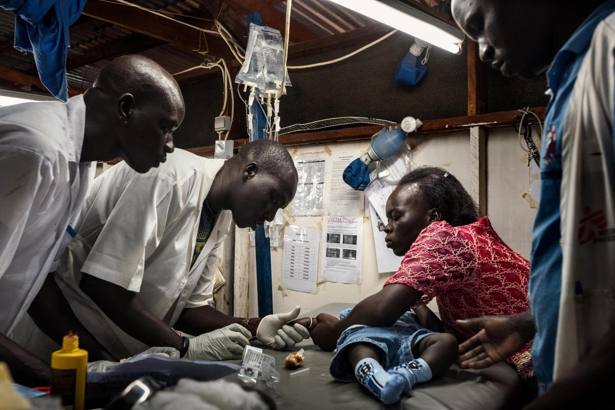 A seven-month-old boy is treated for advanced malaria by staff at Aweil