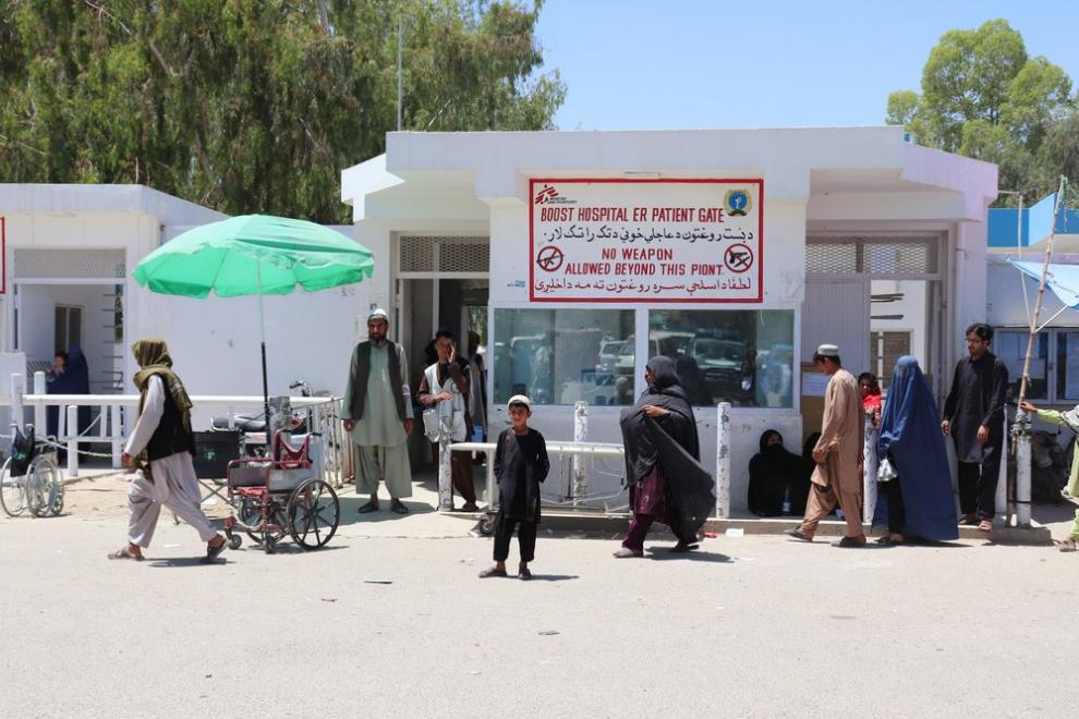 People in front of the main gate of MSF's Boost Hospital
