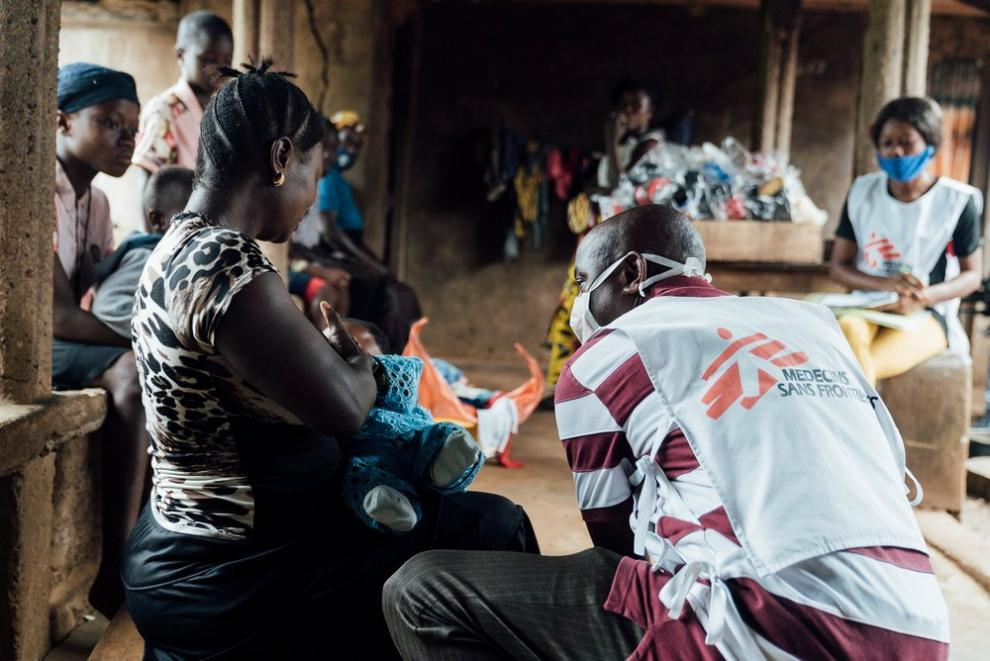 One of the mobile clinic team meets a young patient in Sierra Leone