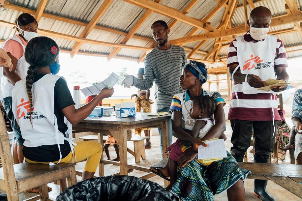 MSF mobile clinic, Bumbeh village, Kenema district. The outreach team checks patients' medical data and vaccination cards