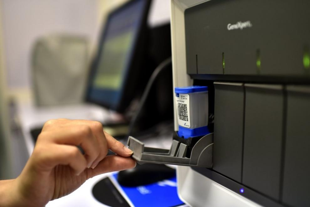 Cartridges being loaded into a GeneXpert® machine at an MSF lab