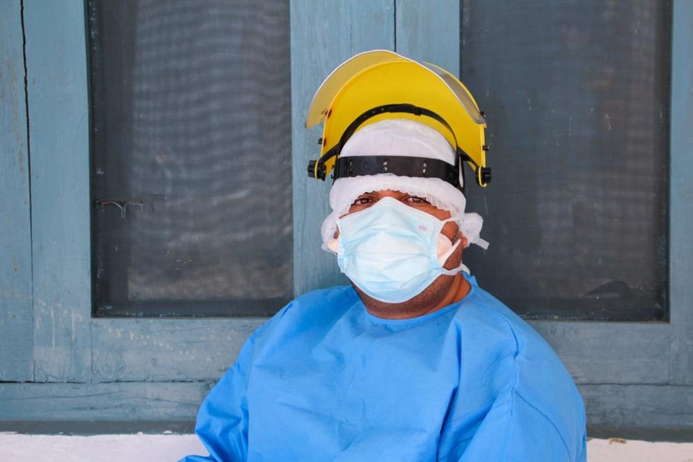 An MSF staff member wearing personal protection equipment (PPE) inside the COVID-19 consultation room at Timergara hospital in Peshawar