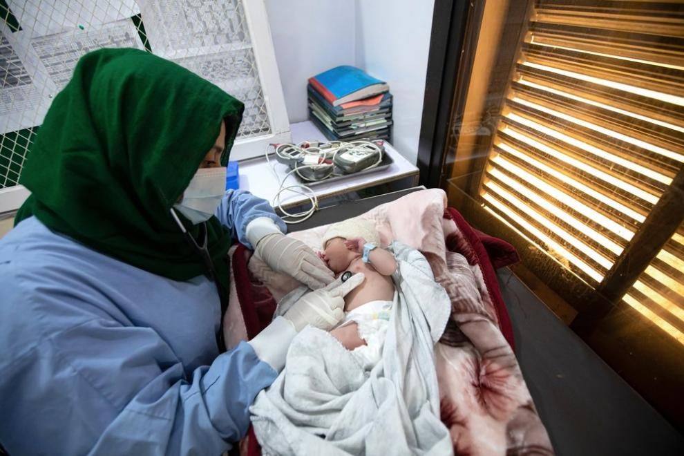 An MSF doctor checks on the vital signs of a newborn girl in the mother and child unit at the hospital in Timergara