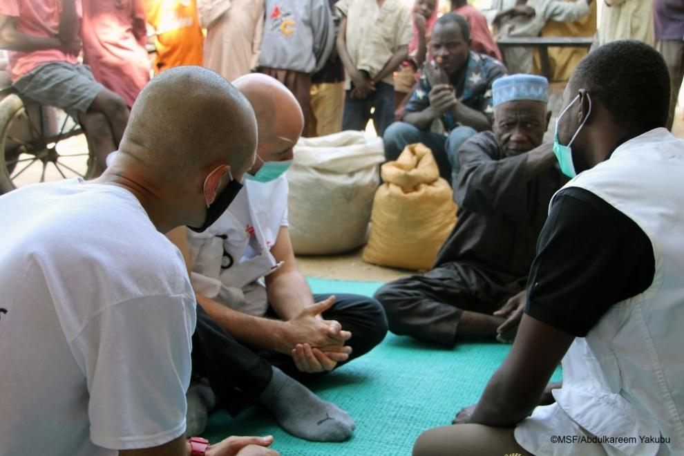 An MSF team meet with a local community leader in Borno State