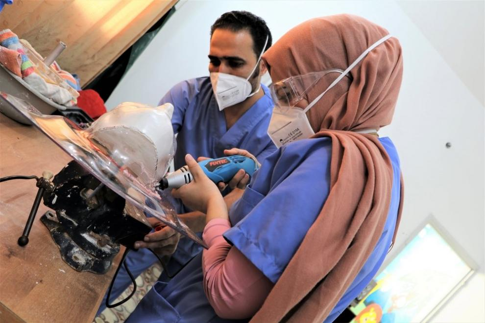 MSF physiotherapists make a compressive face masks for a burn patient