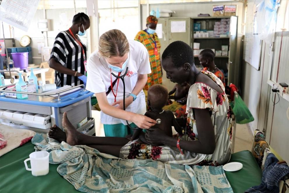 MSF doctor Joy Clarke examines a patient being treated for malnutrition in Bentiu camp