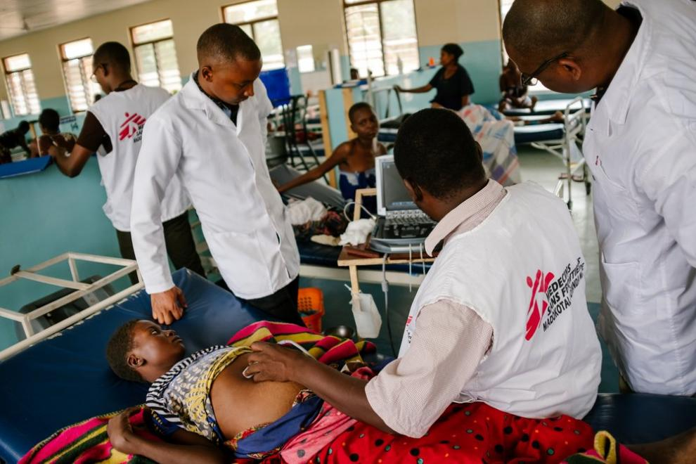 MSF staff examine a patient with advanced HIV at Nsanje district hospital, Malawi