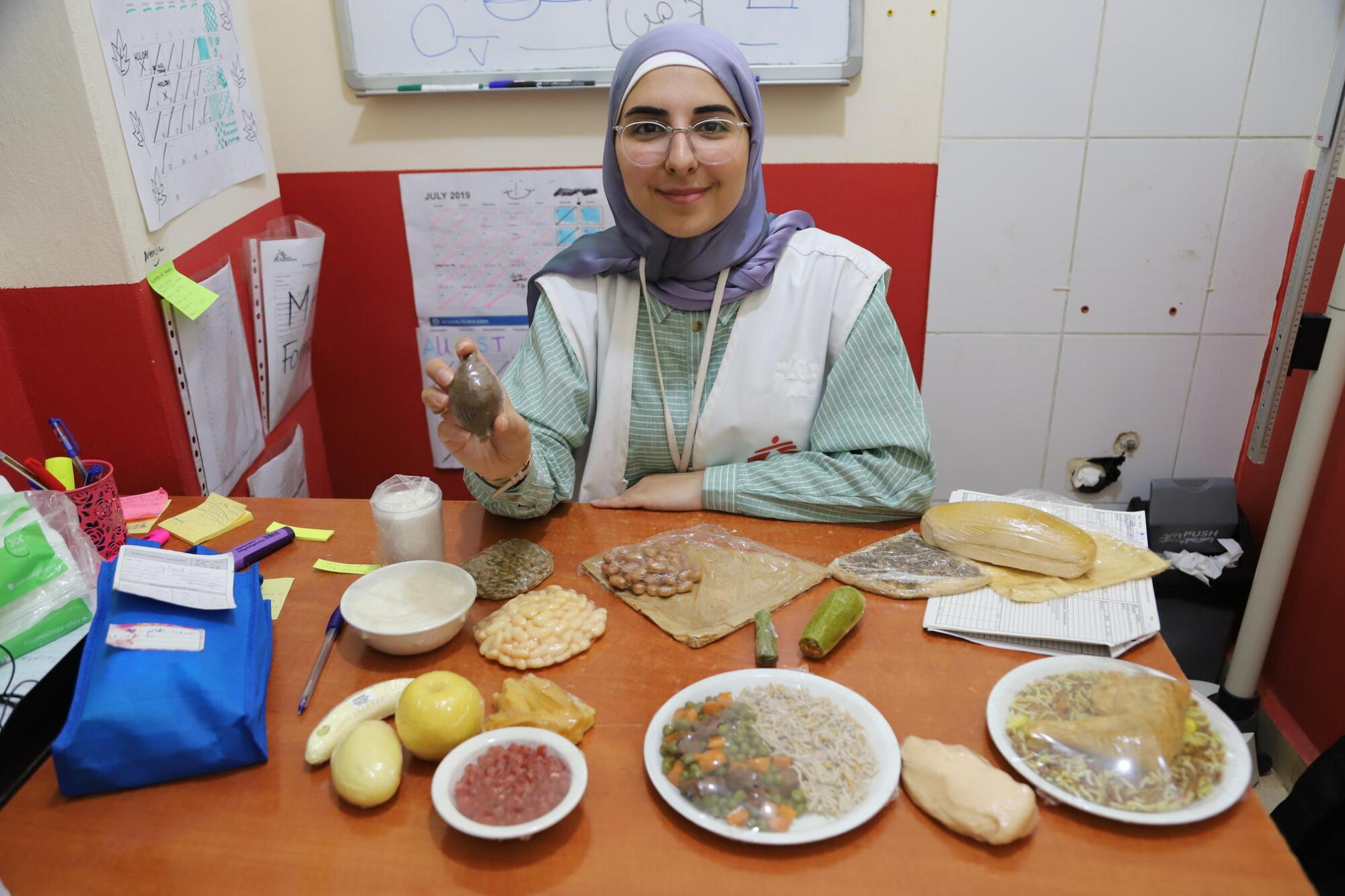 Zeinab prepares an education session on nutrition in the MSF clinic at Shatila refugee camp, south Beirut