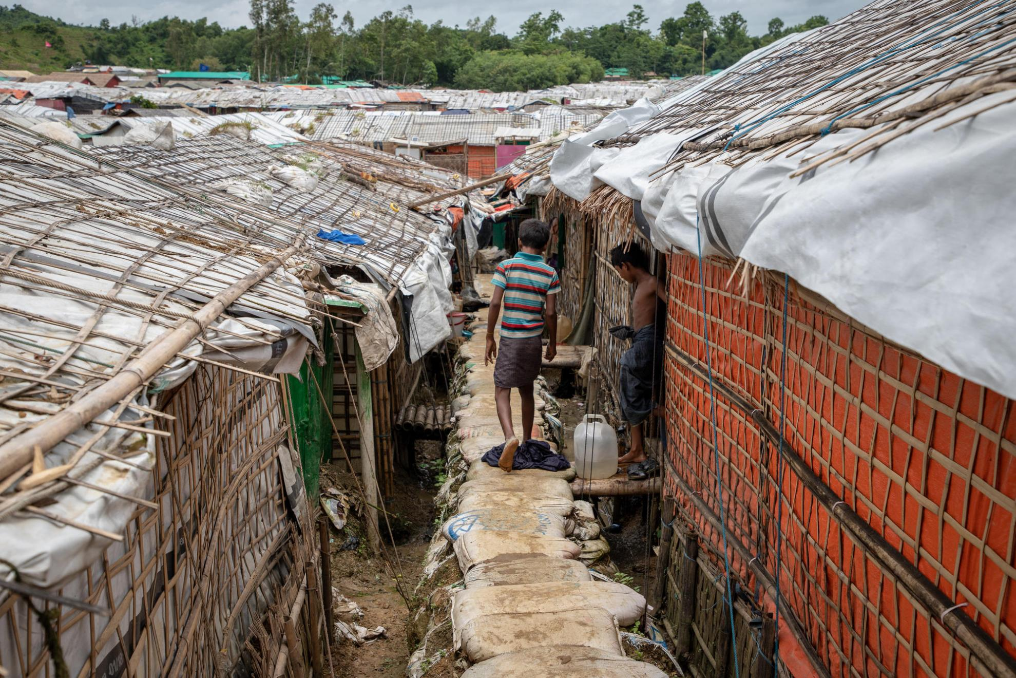 A child walks between makeshift houses in the Unchiprang camp in Cox's Bazar, Bangladesh