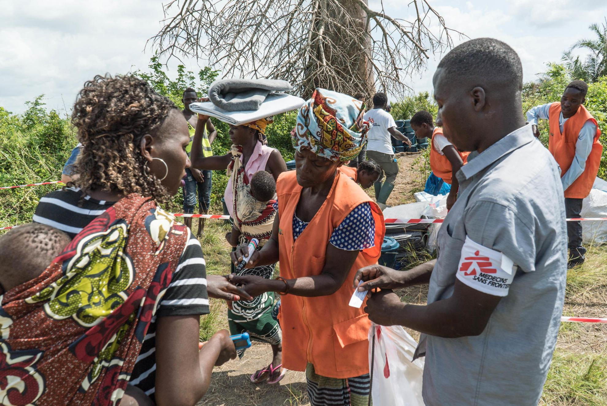 "An MSF team distributes essential ""non-food items"" to cyclone survivors in a remote area of Mozambique"