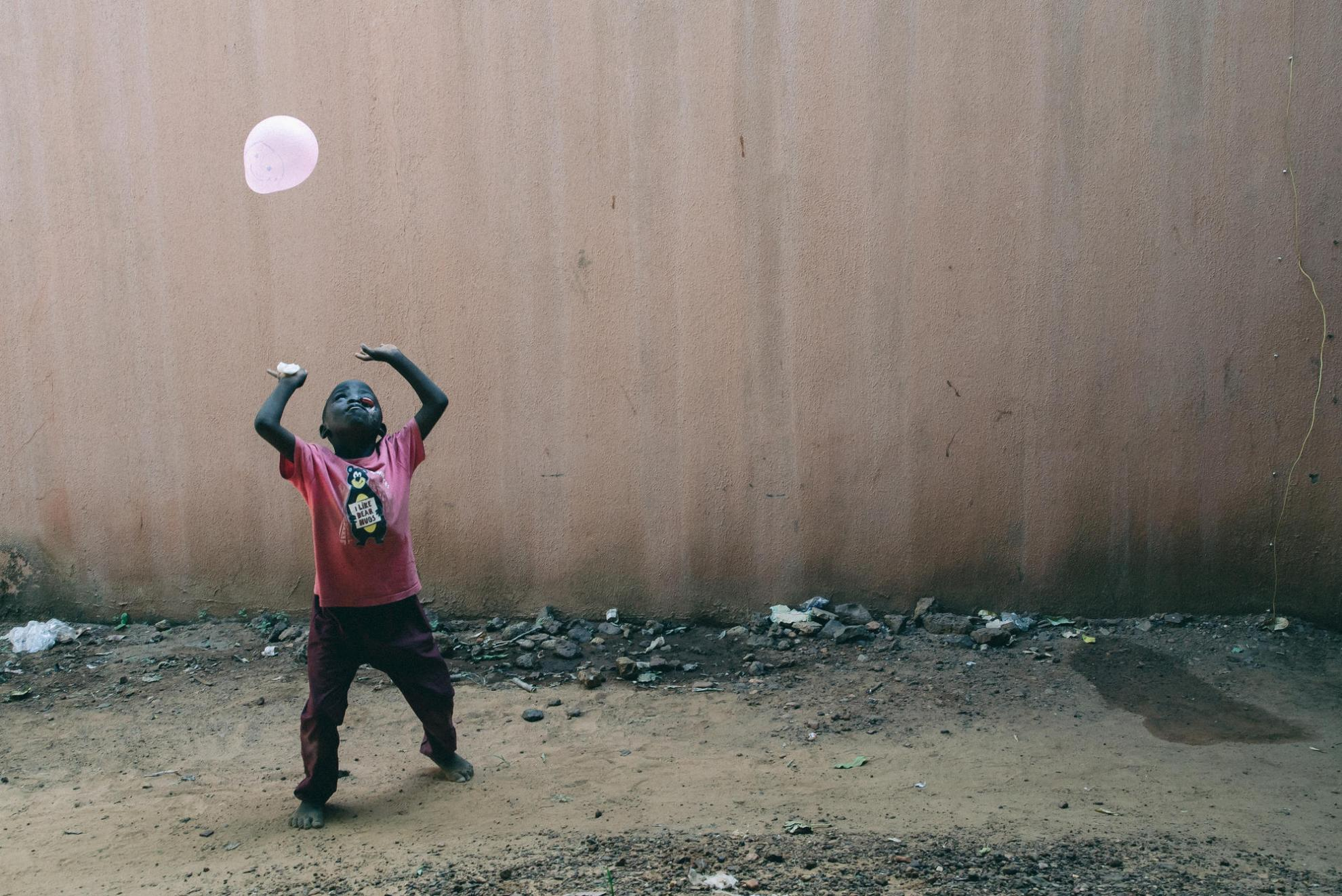 At Sokoto hospital, eight-year-old Umar plays with a balloon while waiting for surgery