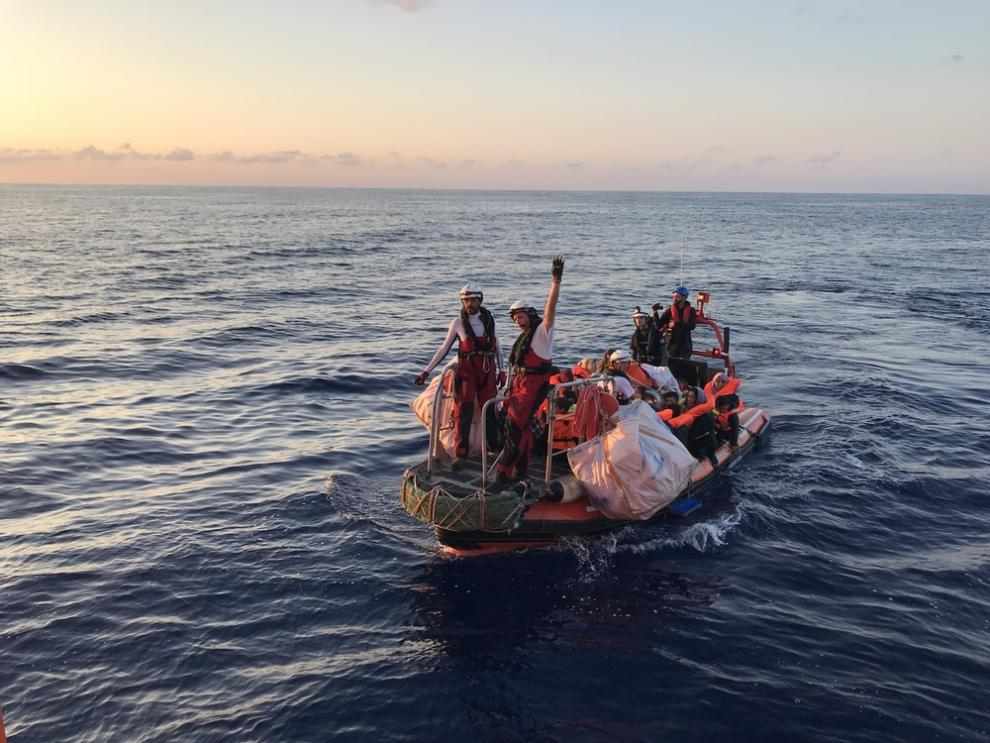 The SOS MEDITERRANEE RHIB returns to the Aquarius with the first group of people rescued from a wooden boat in distress