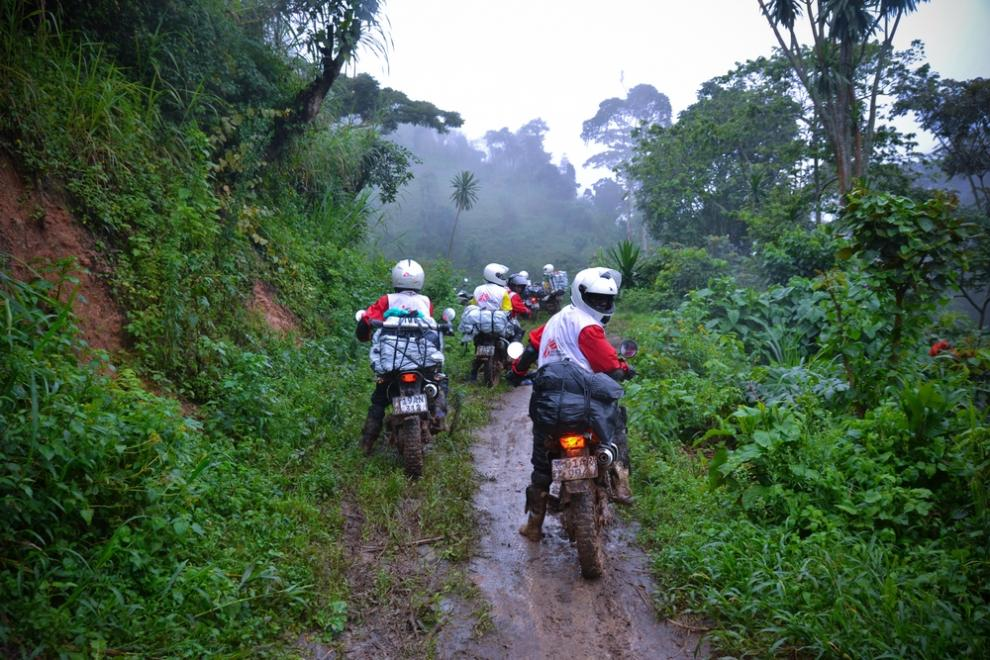 Motorcycles loaded with supplies travelling to the area of a malaria outbreak in North Kivu, Nov 2015.