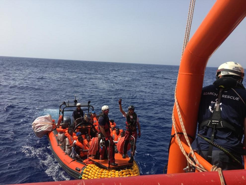 A group of rescued people are transferred to the Ocean Viking - the most vulnerable, such as children, pregnant women and those with medical conditions are rescued first