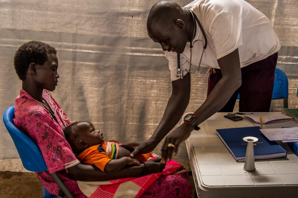An MSF nurse treats a six-month-old boy suffering from pneumonia in Meer, South Sudan